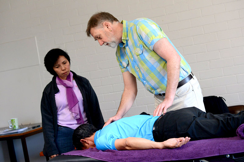 John providing acupressure treatment in Practitioners Course training